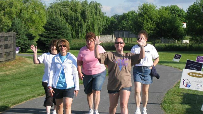 Participants walk in the 2014 Relay for Life at Norlo Park.