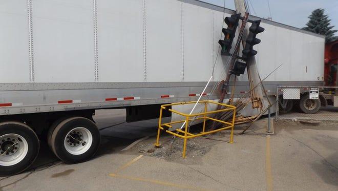 A semi crashed into an electrical pole on Washington Street Tuesday morning.