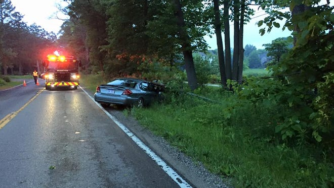 The driver of a Ford Taurus was stuck in the car after a secondary power line fell partially on the car around 6:50 a.m. Thursday.