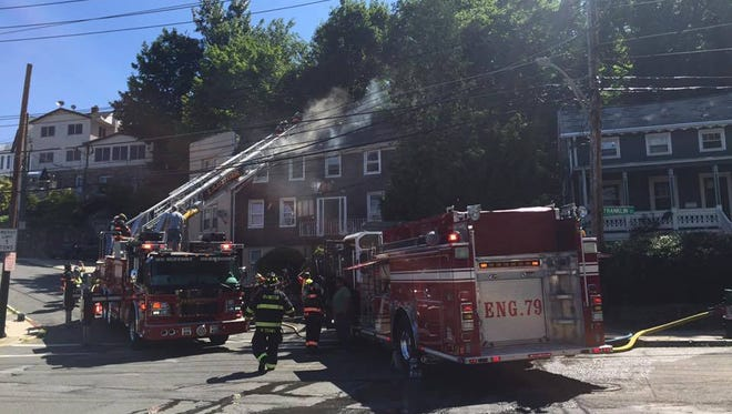 Firefighters battle a structure fire at 16 White St. in Tarrytown Tuesday, June 21.