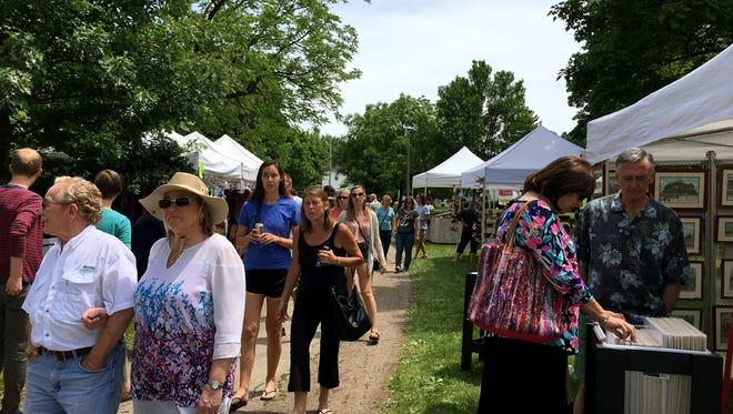 Attendees of the 59th Winnebagoland Art Fair held at South Park June 12.