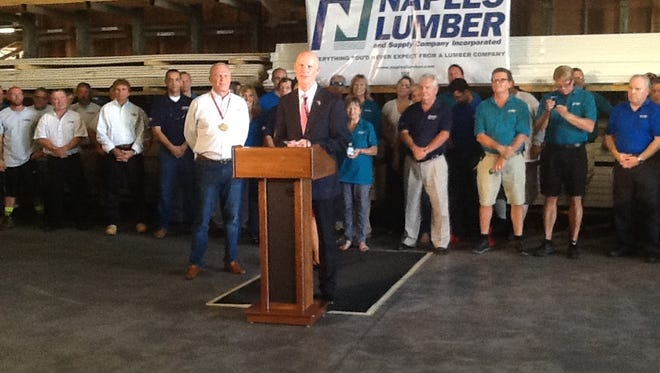 Ron Labbe, the owner of Naples Lumber and Supply, received a Business Ambassador Award from Gov. Rick Scott. Laura Layden/Naples Daily News