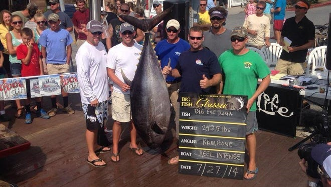 Anglers from Reel Intense hold up a prize-winning tuna from last year's Big Fish Classic.