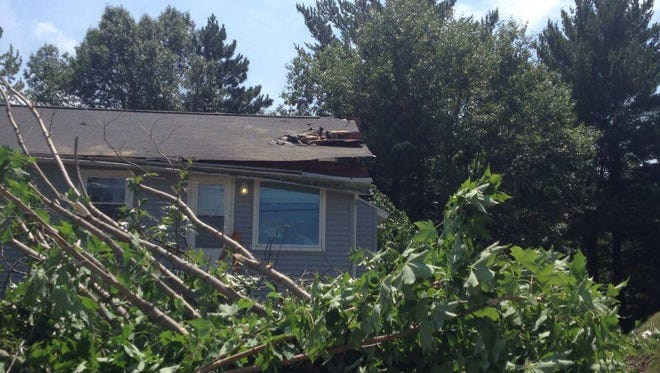 The Grove Avenue home and the tree that damaged it during early morning thunderstorms, Thursday, July 21.