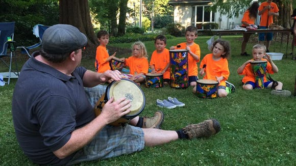 Kids at Peacemakers Camp participated in a drum circle on the final night of camp.