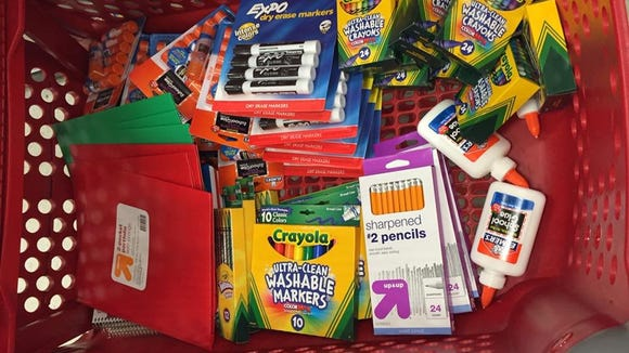 Aaron Bell of Phoenix has triplets starting kindergarten, so he had to multiple his school supply list times three.