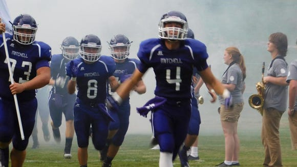 Mitchell players take the field last Friday.