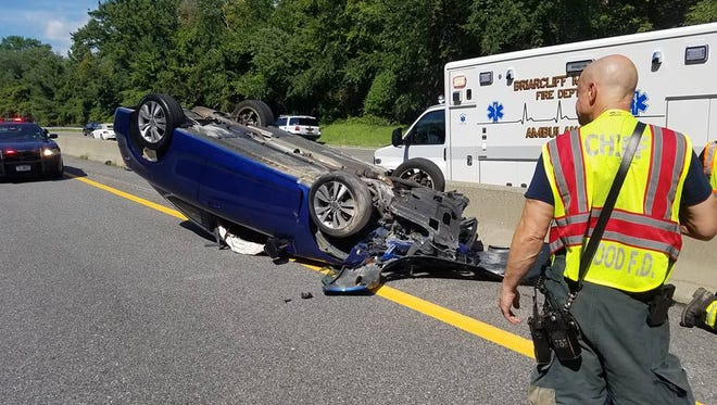 A rollover on the Taconic State Parkway in Briarcliff is blocked three lanes of traffic.