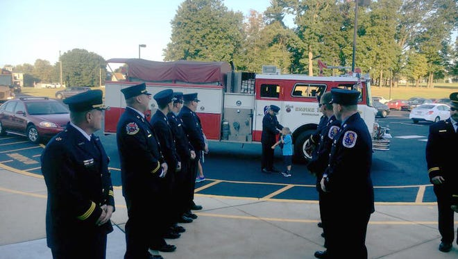 The children of fallen Prince George's County Fire Lt. Chris Hill were escorted to their first day of school at West Manheim Elementary School Tuesday by Maryland firefighter and paramedic associations.