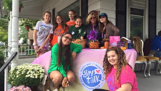 A group from Girl Talk Marlton set up at a Marlton festival in September of 2015. They are Alyssa Crammer (top left), Marissa Marrano, Olivia Bortnick, Liz Marrano, Girl Talk Marlton founder Mary Beth Iannarella, Victoria Mesi and Erica Jacobsen (bottom left) and Gianna Colangelo. The Marlton chapter of Girl Talk, Inc., offers peer-to-peer mentoring and holds many volunteer events in the community.