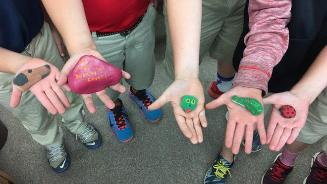 """""""Rocking"""" is the newest way for families to spread joy and encouragement throughout the community. Thousands have taken to social media to share photos of the stones they have found."""