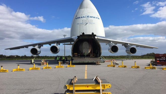 A United Launch Alliance Atlas V booster was offloaded from an Antonov aircraft on Monday morning at Cape Canaveral Air Force Station.