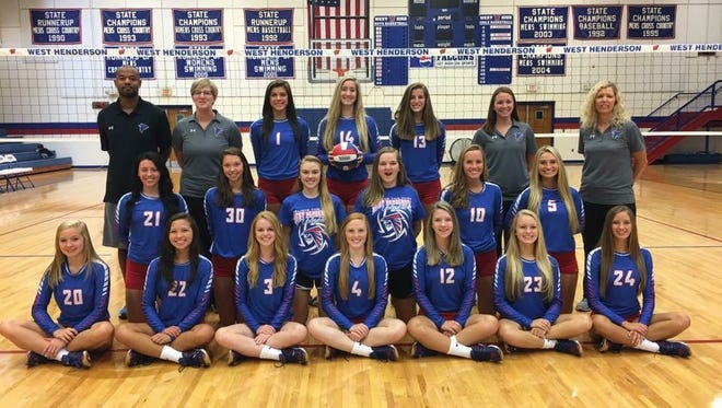 West Henderson's volleyball team and coaches.