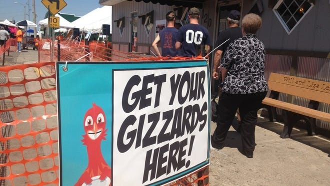 A sign outside of Joe's Gizzard City in downtown Potterville directed residents to where they could get a taste of the fried snack during the Gizzard Festival in 2013. Organizers say they aren't sure if it will continue in 2018.
