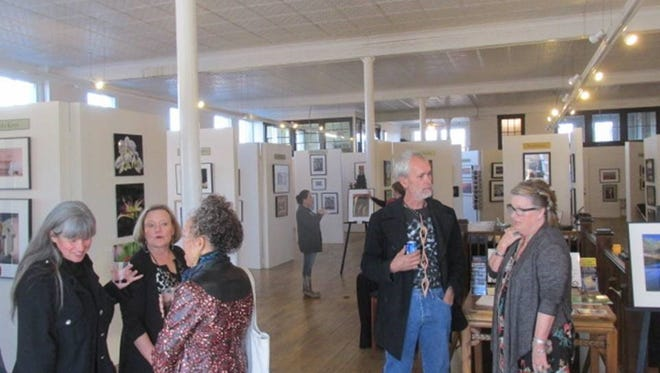 Guests poured into the Tularosa Basin Gallery of Photography's Fall and Winter Open House Saturday in Carrizozo.