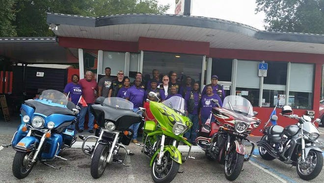 Members of Parents Against Injustice and Negligence and local motorcyclists at PAIN's 2015 charity motorcycle ride.