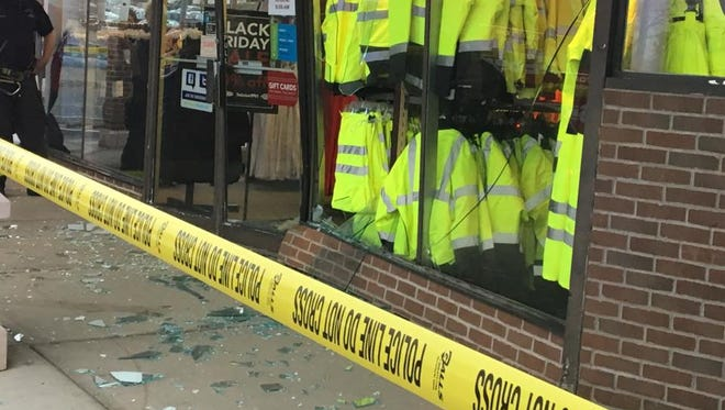 Shattered glass littered nearby sidewalks after a Black Friday shopper crashed his car into a retail store located at a crowded Route 46 Clifton shopping center.