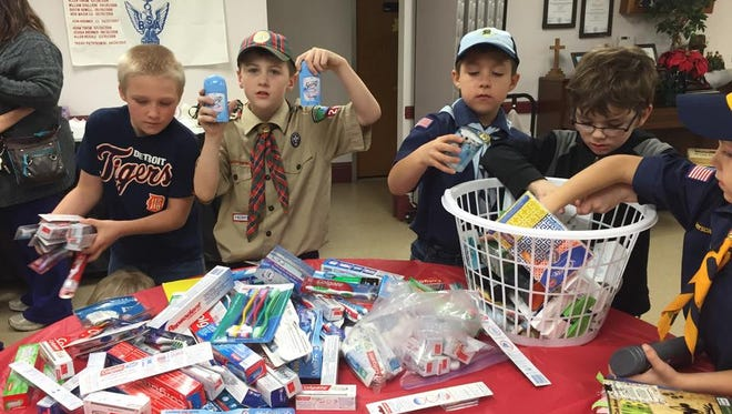 Marine City Cub Scout Pack 296 organizing donations during their 2015 care package drive.