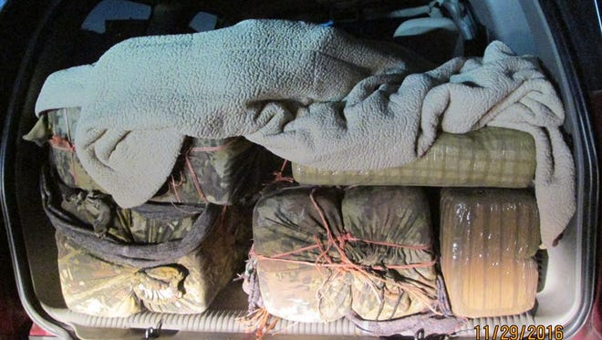 The trunk of a GMC truck was found loaded with marijuana after a high-speed chase in Pinal County.