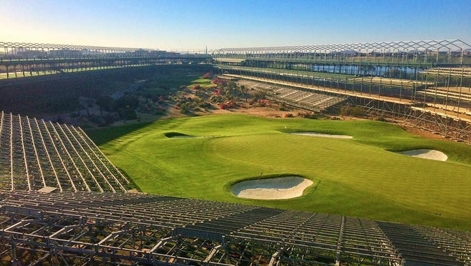 A view of the 16th hole at the TPC Scottsdale with the grandstands under construction for the upcoming Waste Management Phoenix Open.
