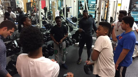 Teenage boys work out together at Northside YMCA in Social Fitness Club, designed to work on their social skills as well as their fitness.