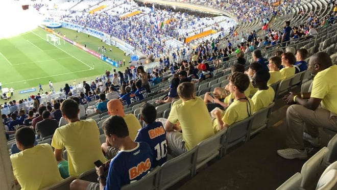 Members of Felipe Lawall's group of local players watch a match between Cruzeiros FC and Santos FC in Belo Horizonte, Brazil. The teams played to a 2-2 draw.