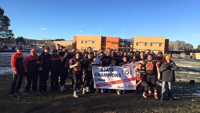 The Capitan Tigers celebrate their Class 3A Football State Championship title in Capitan Saturday. It is the team's first since 1982.
