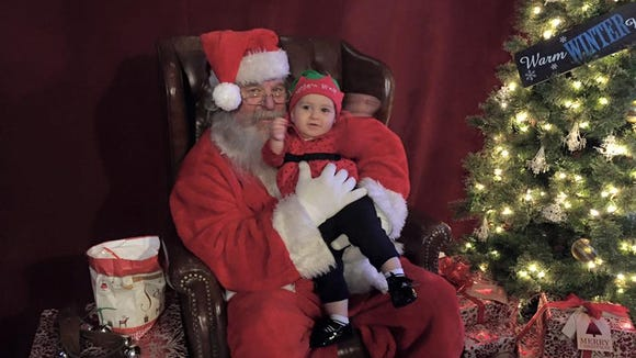 CiCi meeting Santa for the first time at Lights of Hope last year. This is the most cooperative she's ever been for a photo. EVER.