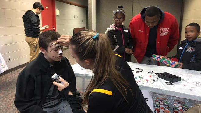 Volunteer Stephanie Jankiewicz was kept busy painting faces.
