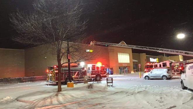Firefighters extinguished a fire in a Grand Chute Walmart's rooftop refrigeration unit early Saturday morning.