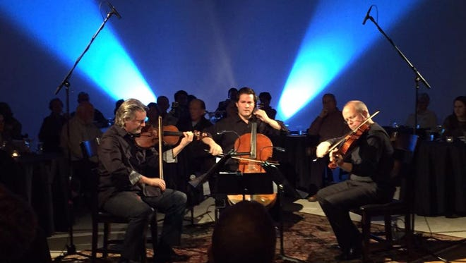Grammy Award-nominated cellist and El Paso Pro-Music artistic director Zuill Bailey, center, will be joined by violinist Kurt Nikkanen, right, and viola player Scott Rawls at noon Thursday during the Bach's Lunch concert at the El Paso Museum of Art.