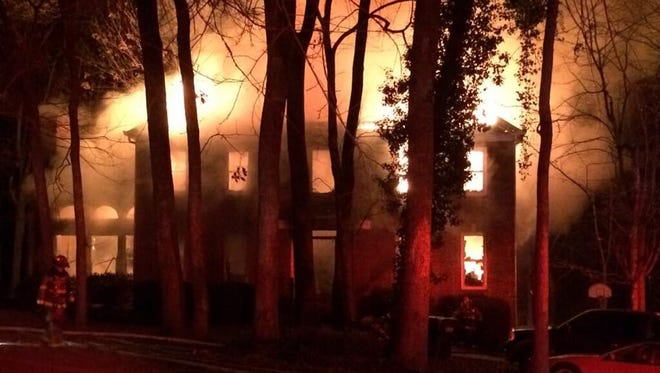 A Brentwood home is engulfed in flames Dec. 22, 2016.