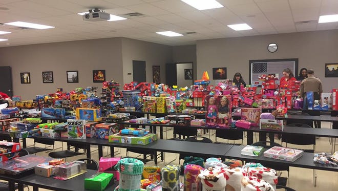 Madison County Fire Department sorts through presents donated in a December toy drive for Beyond the Badge.
