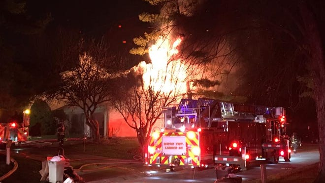Wayne Township firefighters battle a blaze that destroyed a west side townhome.