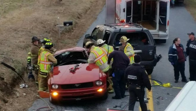 Firefighters responded to a car crash on Thursday afternoon involving a school bus.