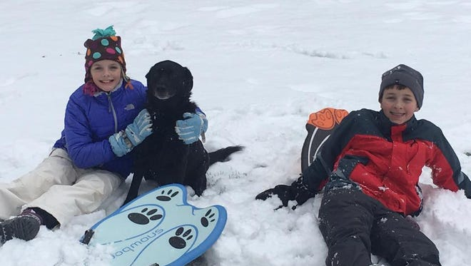 Local students Makayla and Spencer Chase playing in the snow.