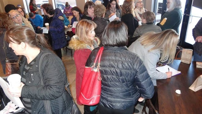 Members of NJ 11th for Change gather at a Starbucks in Morristown Jan. 13, 2017.