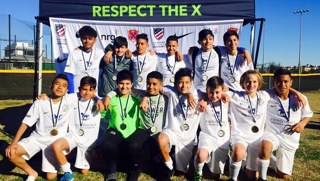 """The El Paso Cosmos FC 04 U13 Select soccer team won the Houston Express NRG Power Cup 2017 this past weekend, outscoring its four opponents 20-2, including a 3-0 over ID Club Division in the finals.  Team members are top row (left to right): Alvaro Vargas, Azaf """"Tiki"""" Castaneda, Omar """"Gio"""" Mora, Anthony Diaz, Ruben """"Ozzy"""" Santos and Axel """"Guero"""" Castaneda. Bottom row (left to right): Edgar """"Jr"""" Hernandez, Daniel """"Gordo"""" Valenzuela, Sebastian Ortega, Jeremy Rueda, Rocky Perez, Dan Schydlower, Rory Crowley, Rudy Garcia and Orlando Ortez (not pictured).   The team is coached by Javier McDonald."""
