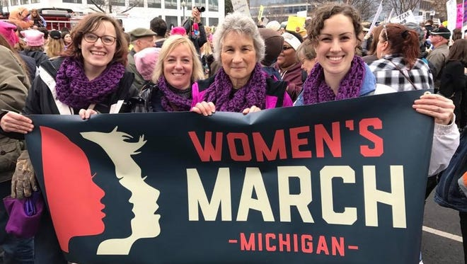 A group of women hold a Women's March Michigan banner at the Women's March on Washington on Jan. 21. On the far right is Megan Collier of Sault Ste. Marie.