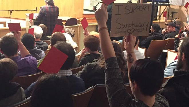 At least 130 people attended in City Council's chambers a meeting Monday night to discuss whether Lansing should become a sanctuary city for undocumented immigrants. Several people who couldn't get inside  the meeting watched a live broadcast in the lobby of City Hall.