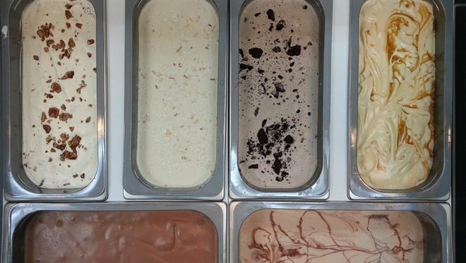 Area 51 uses natural, in-season produce and ingredients, and often buys from the Hernando Farmer's Market. Flavors include (top, from left) Bourbon Butter Pecan, Coconut Brown Sugar, Cookies and Cream, and Salted Caramel, and (bottom, from left) Dutch Chocolate and Peanut Butter with Dark Chocolate Swirl.