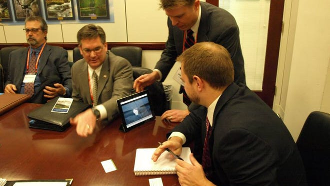 A member of Senator Johnson's staff view a video about Great Lakes restoration progress in Frog Bay.