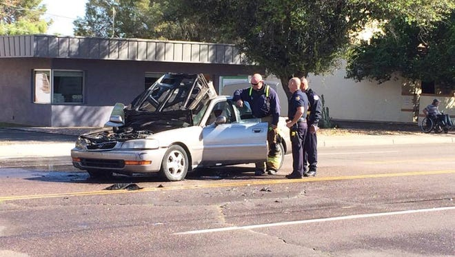 A small car fire erupted in flames on Thomas Road near Third Street in Phoenix on March 16, 2017. The three people in the car were unharmed.