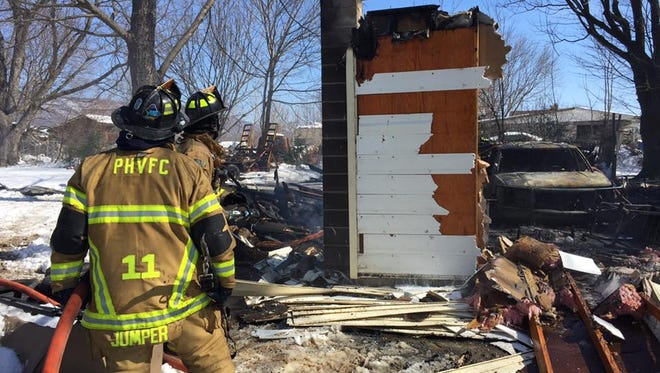 Part of an exterior wall still stands after a fire at a house at 16957 Cumberland Highway, Newburg.