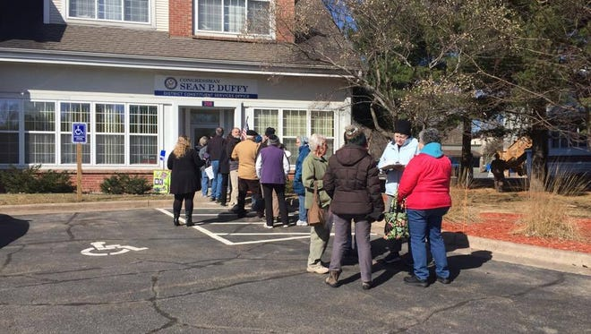 Residents line up outside of US Congressman Sean Duffy's Wausau office.