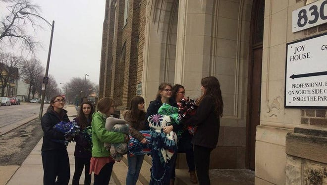 The Sheboygan North Interact Club distributes tie blankets to those in need in Milwaukee.