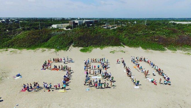 """Conservation group Citizens for Clean Water spell out """"SB 10"""" to show its support for Senate Bill 10 on March 25, 2017, in Stuart. The bill calls for the buying of land south of Lake Okeechobee to build a reservoir to help alleviate toxic blue-green algae discharges."""