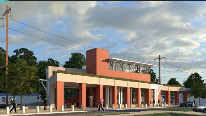 An artist rendering of the train station expected to appear in the coming years near the University of Delaware campus. The state currently is taking bids on the first phase of the project, which includes a parking lot and access improvements.