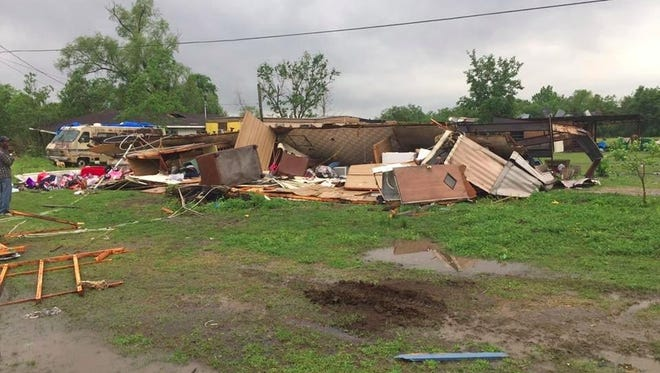 A tornado overturned this single-wide trailer Sunday near Breaux Bridge, claiming two lives.
