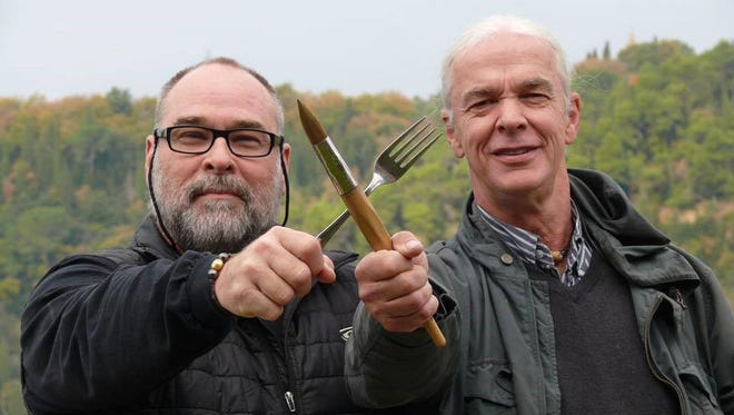 Restaurateur Robert St. John, left, and watercolorist Wyatt Waters are leading a tour group in northern Italy.